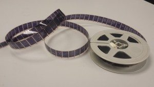 A roll of 16mm negative microfilm