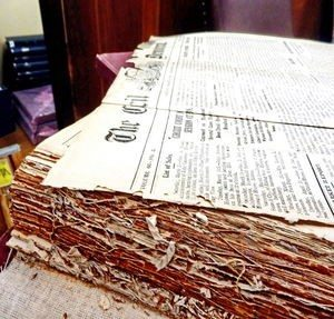 The Historical Society of Cecil County (Md.) implemented a number of strategies to preserve aging documents, such as the bound records shown here, and to make the materials available in modern formats.